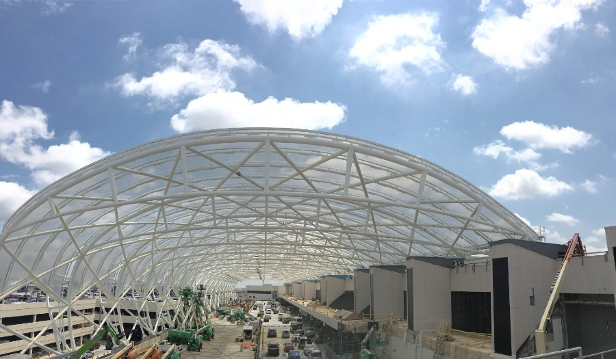 An image of the Atlanta Hartsfield Jackson Airport from outside looking down the steel and glass canopy