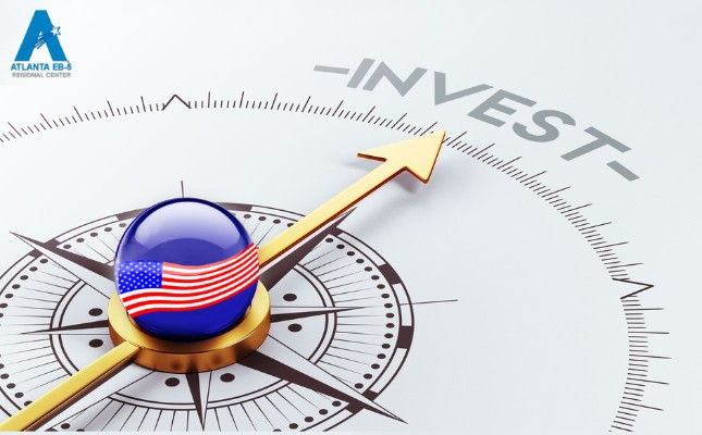 "An image of a compass with a gold directional arrow pointing at the word ""invest"""