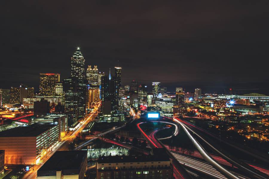 an image of the atlanta ga skyline at night with car lights streaming accross the image, it looks very cool