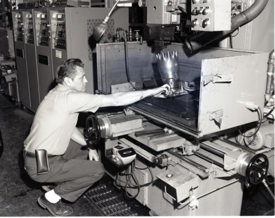 a man working on a machine at an investor visa program manufacturing business