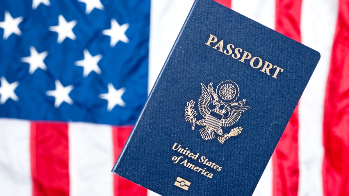 American Flag background with an image of a U.S. Passport in the foreground